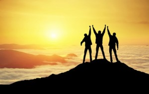 45088208 - silhouettes of team on mountain peak. sport and active life concept